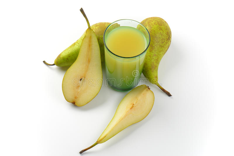 Glass of pear juice. And fresh pears next to it royalty free stock image