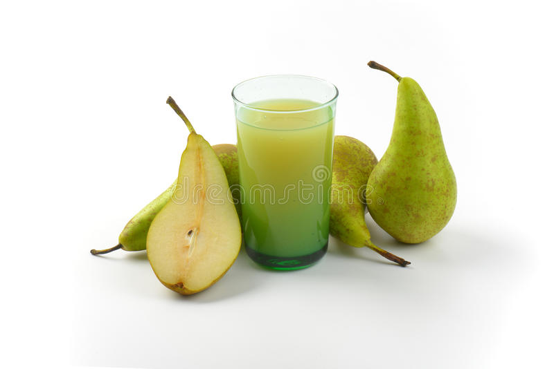 Glass of pear juice. And fresh pears next to it stock photos