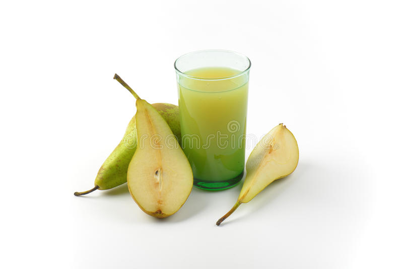 Glass of pear juice. And fresh pears next to it stock photo