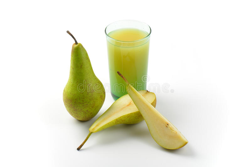 Glass of pear juice. And fresh pears next to it stock photography