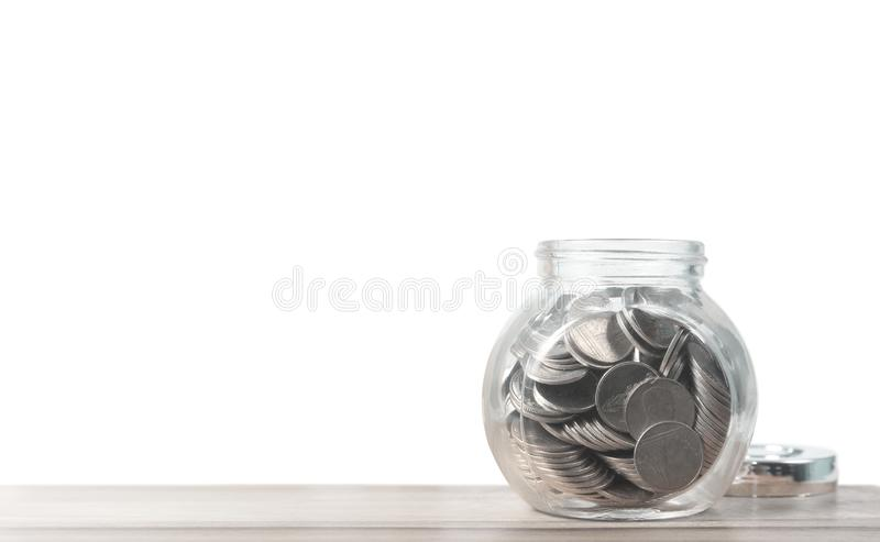 Glass piggy bank saving money concept,and coins stock photography