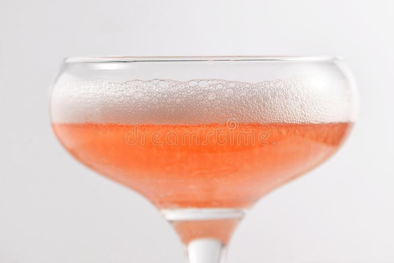 Glass of pink sparkling wine royalty free stock photo