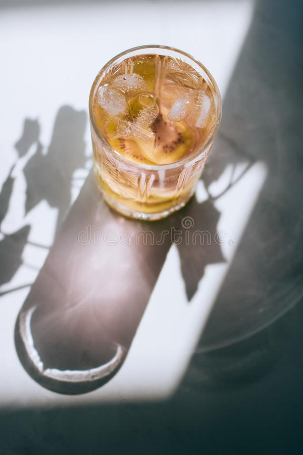 A glass of pink wine in a crystal glass on a marble background. Bright sun royalty free stock photos
