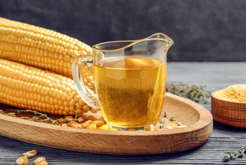 Glass pitcher with corn oil stock photos