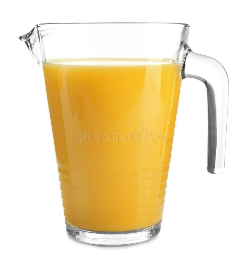 Glass pitcher of fresh orange juice. On white background royalty free stock photos