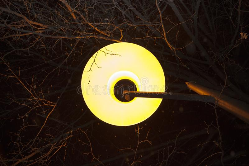 Glass plafond of yellow color. Street lamp against the dark sky royalty free stock photo