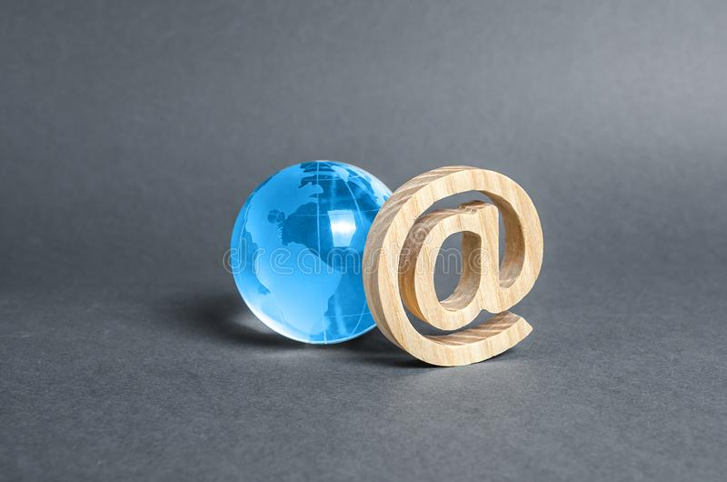 Glass planet earth globe and email internet symbol. World Wide Web. Contacts. Business tools. Internet and global communication stock photo