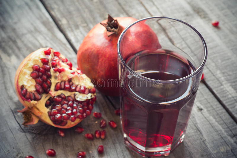 Glass of pomegranate juice stock photo