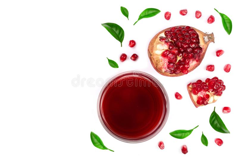 A glass of pomegranate juice with fresh pomegranate fruits decorated with leaves isolated on white background. Top view royalty free stock photography