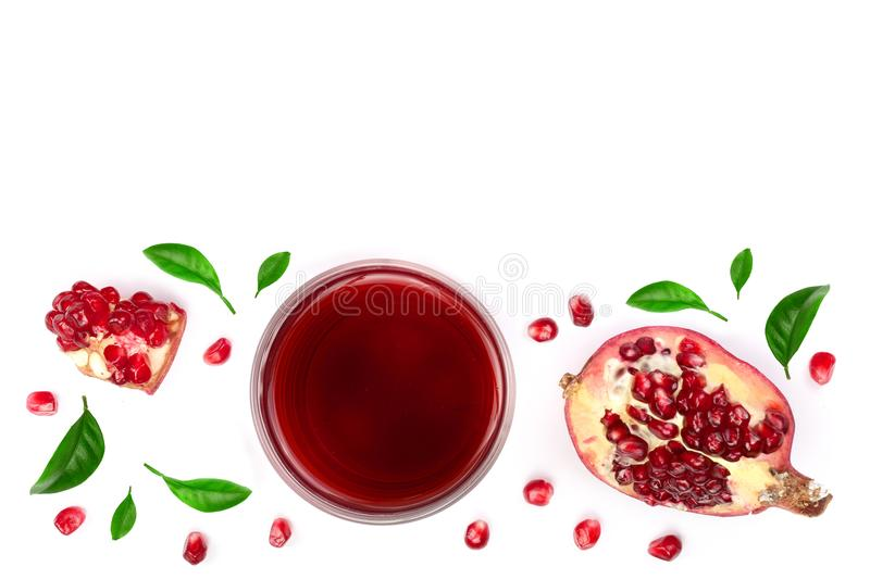 A glass of pomegranate juice with fresh pomegranate fruits decorated with leaves isolated on white background. Top view stock photography