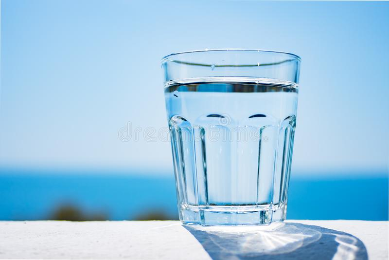 A Glass Of Pure Water Against The Background Of The Sea. Healthy Lifestyle.  Stock Photo - Image of life, nature: 124413930