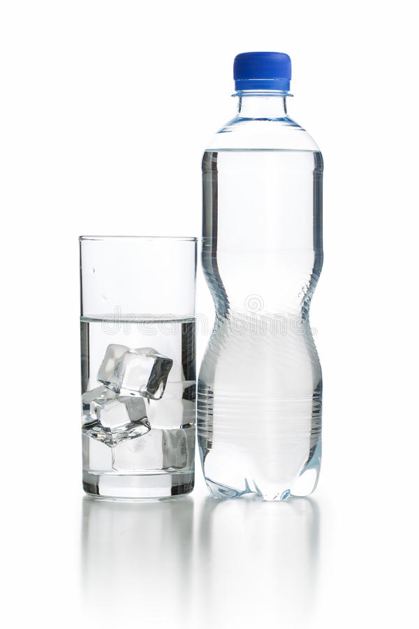 Glass of pure water with ice cubes. Glass of pure water with ice cubes and bottle water royalty free stock photos