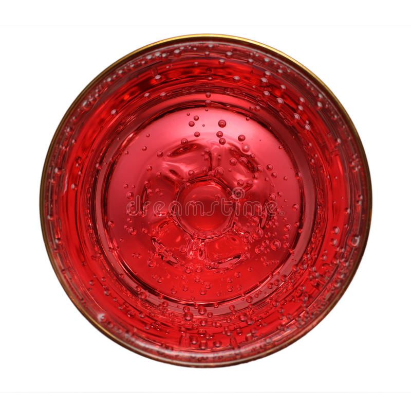 Glass with red aerated water. Close-up view from above on glass with red aerated water royalty free stock image