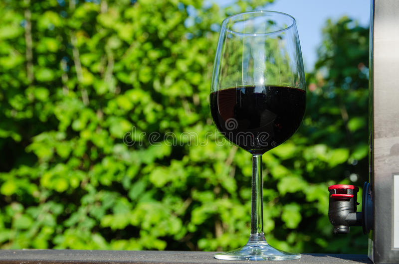 A glass of red Bag-in-Box wine royalty free stock photography