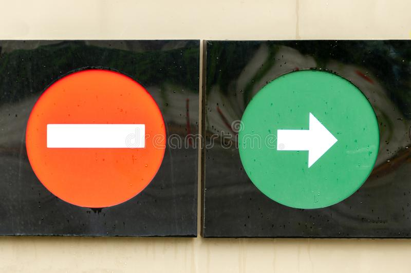 Glass, red and green, road sign.  Caution wrong direction, do not enter traffic sign, moving to the right only. Glass, red and green, road sign.  Caution wrong stock image