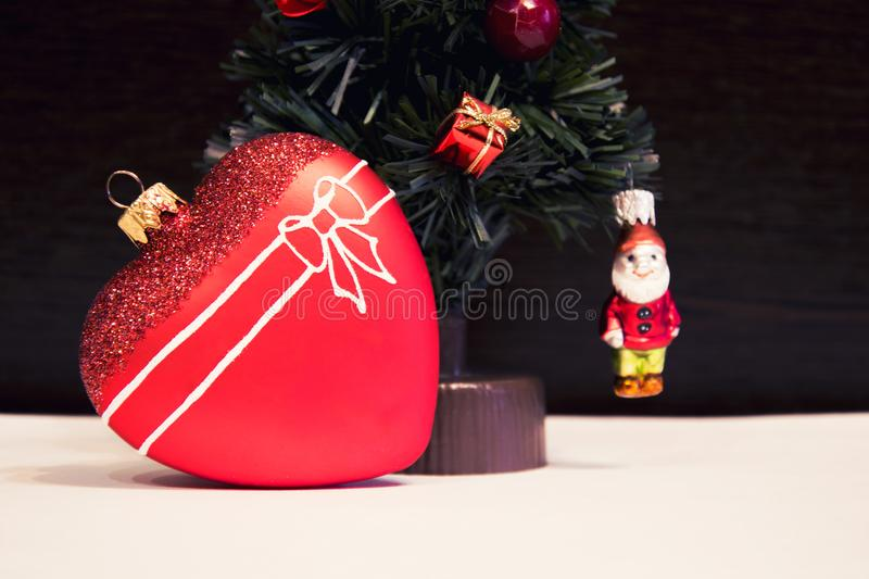 Glass red heart and Christmas decorative Christmas tree. Beautiful New Year Decorations. royalty free stock photos