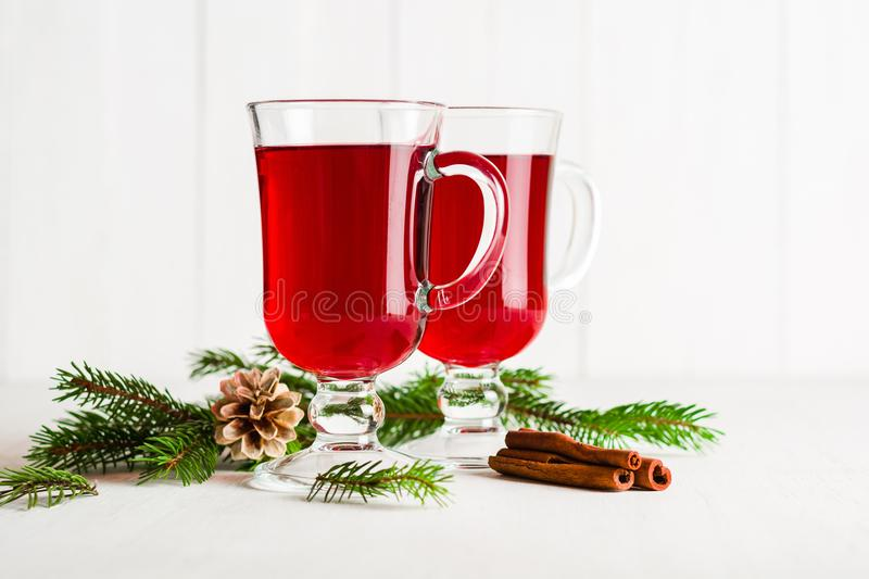 A glass of red hot mulled wine on a light background. Christmas and New Year greeting card. royalty free stock photos