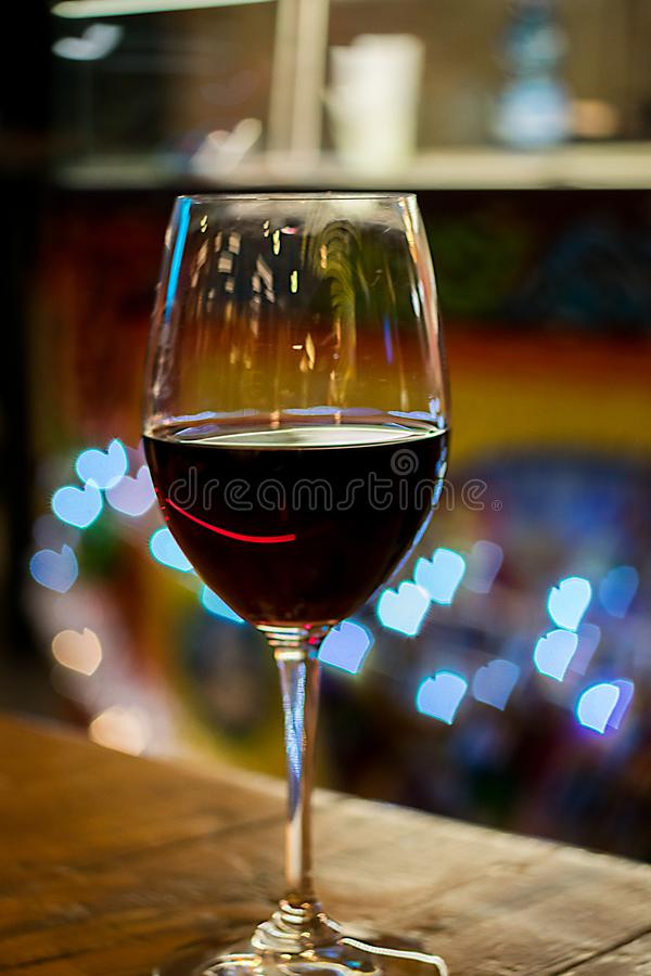 A glass of red Italian wine with bokeh `Heart` royalty free stock image