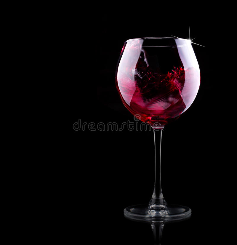 Glass of red splashing wine stock photos