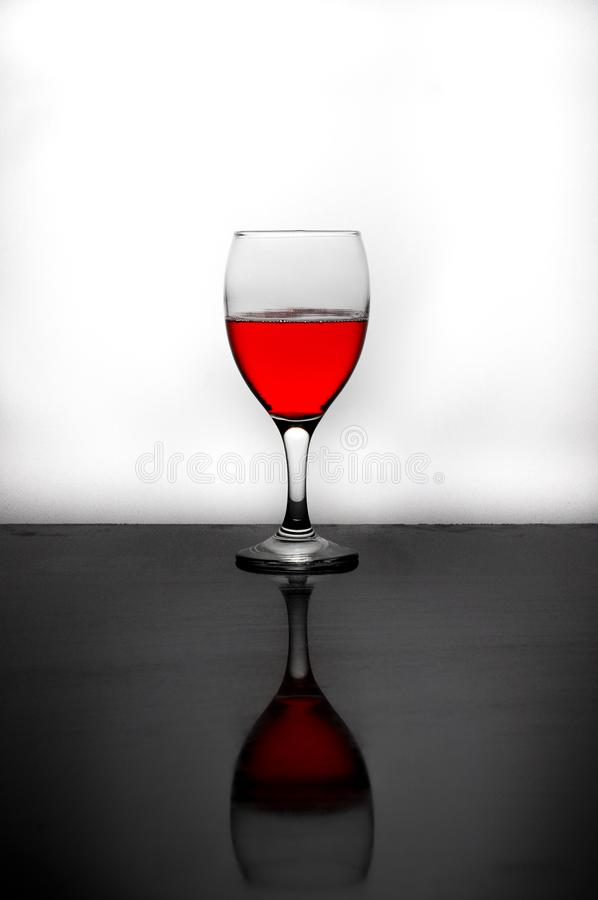 A glass of red water royalty free stock photo