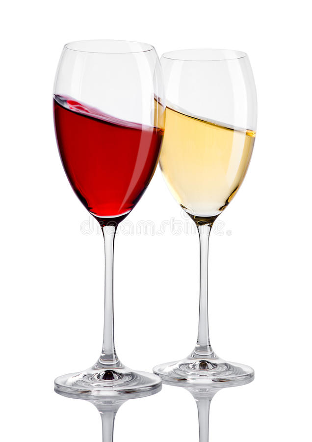 Glass of red and white wine in motion on white stock photos