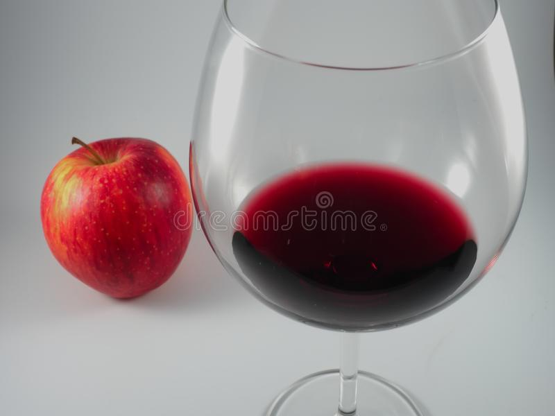 Glass of red wine apple stock images