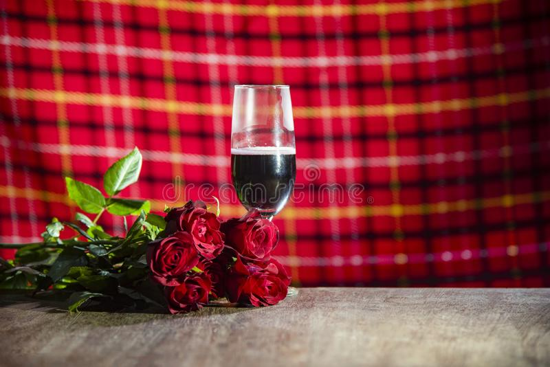Glass of red wine on bar Valentines dinner romantic love concept / Romantic table setting decorated with champagne glass stock photos