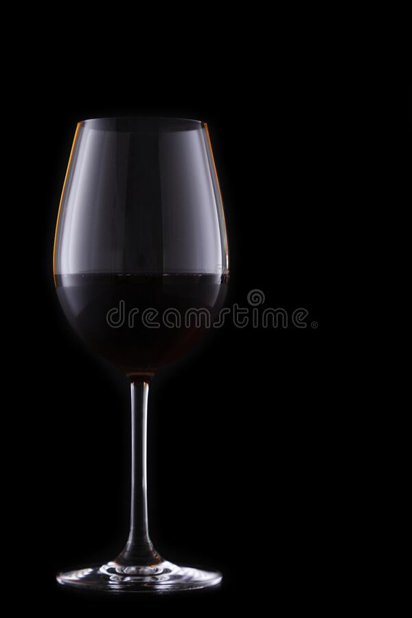 Glass of red wine on black stock images