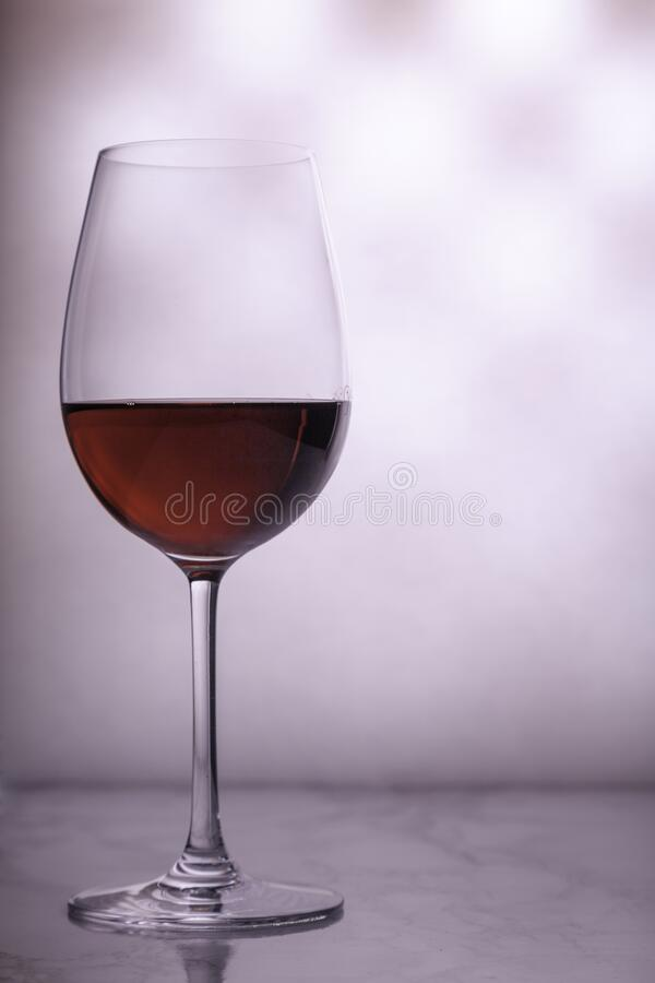 Glass of red wine on blurred background stock photography
