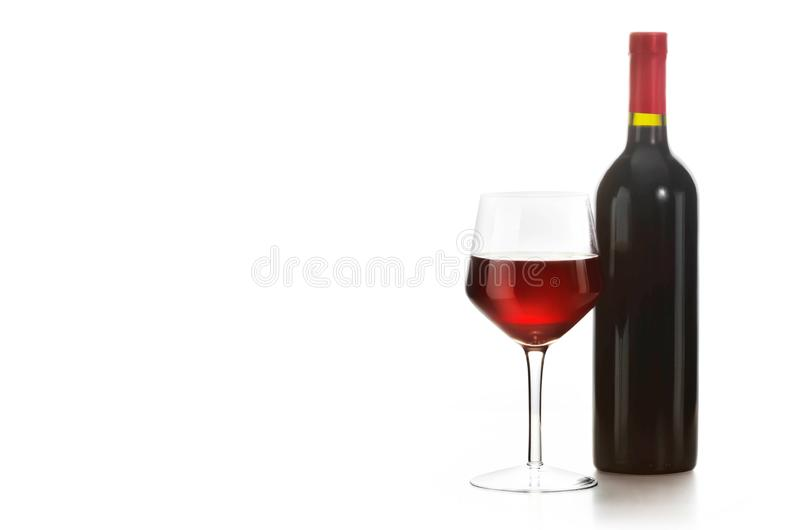 Glass of red wine and a bottle. Isolated over white background royalty free stock photos
