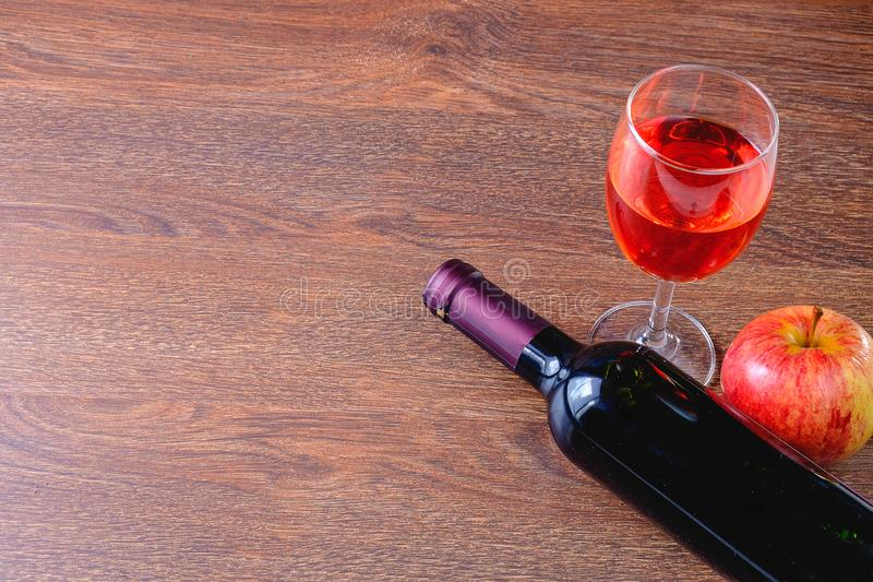 Glass of red wine and a bottle of wine stock images
