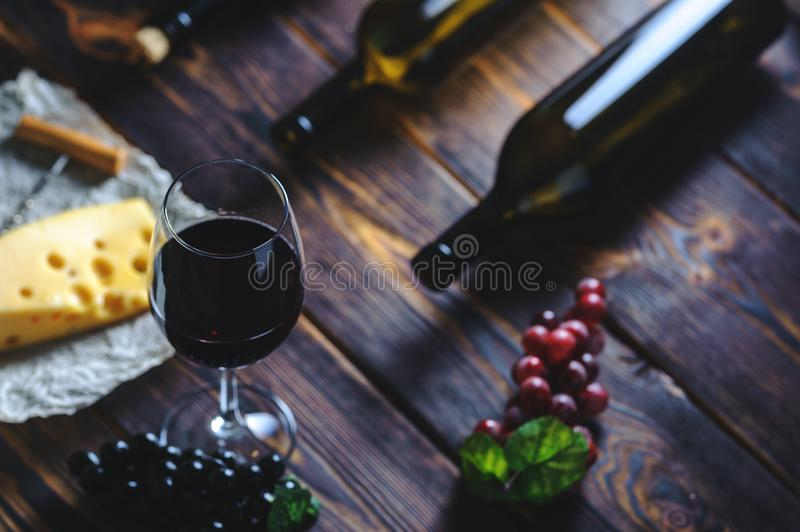 A glass of red wine cheese and grapes stock photography