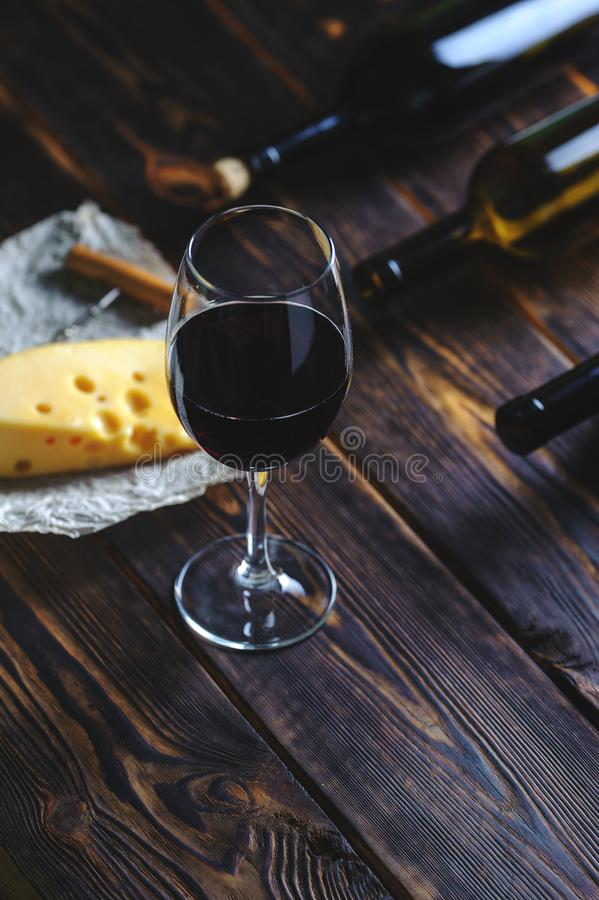 A glass of red wine cheese on a wooden table. Copy space royalty free stock image