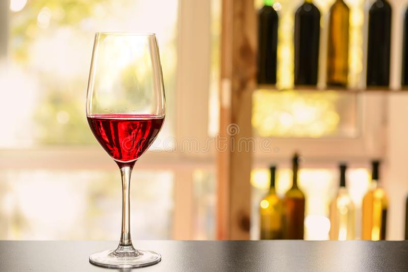 Glass of red wine on dark table royalty free stock images