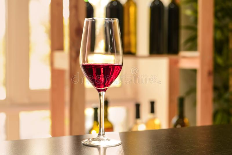 Glass of red wine on dark table stock image