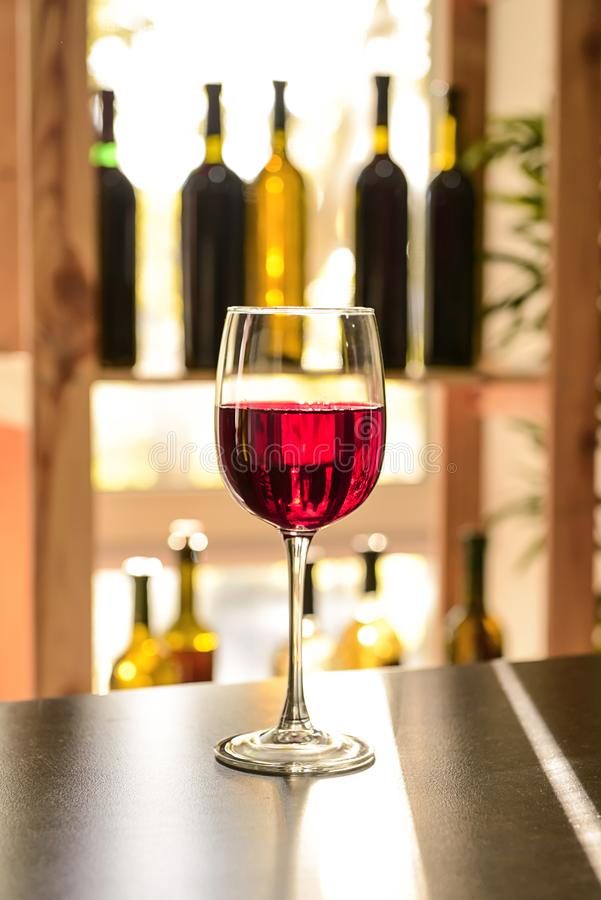 Glass of red wine on dark table stock photography