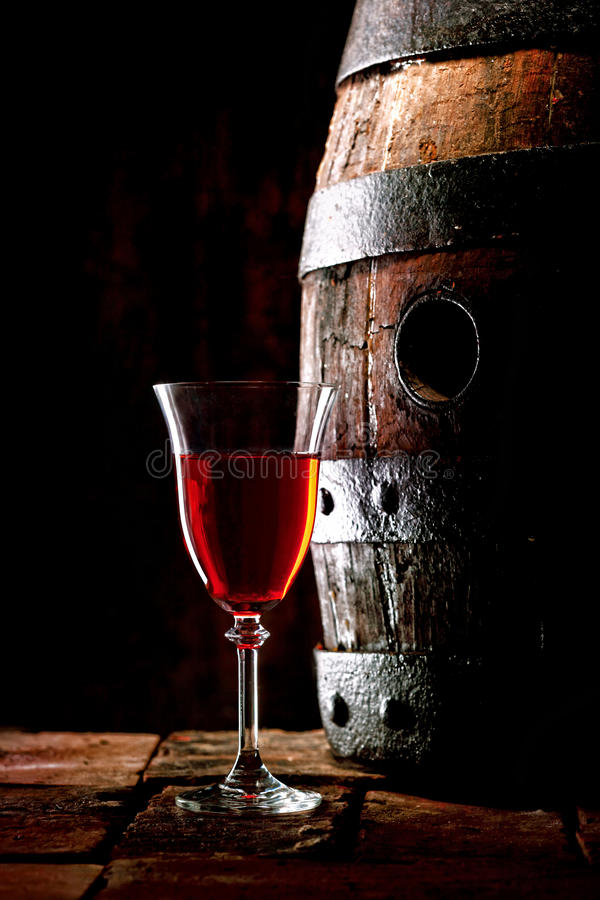Download A Glass Of Red Wine Next To An Oak Cask Royalty Free Stock Image - Image: 30970956