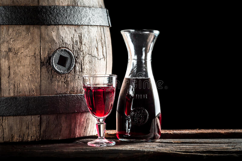 Glass of red wine in the rustic basement stock photo