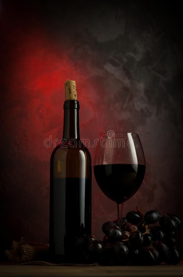 Glass of red wine on the table. Ready to consume royalty free stock image