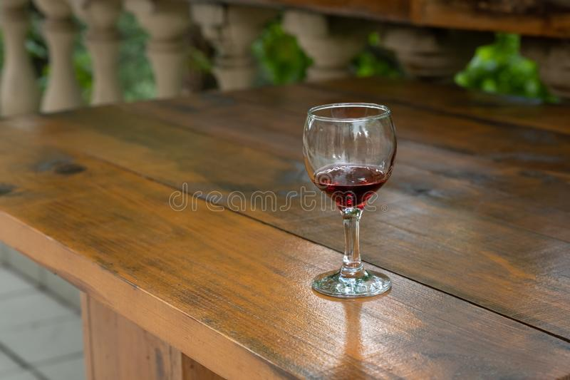 Glass with red wine, tasting, restaurant. Table, background, drink, wooden, winery, alcohol, wineglass, beverage, celebration, grape, liquid, party, concept stock photos