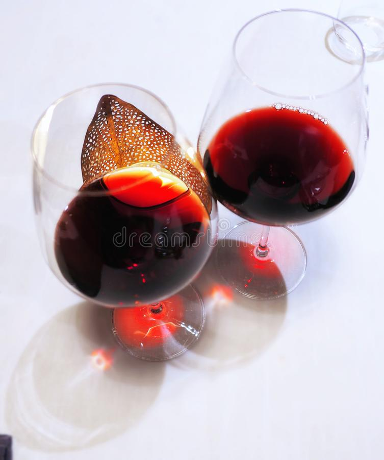 Glass of red wine with candle stock images