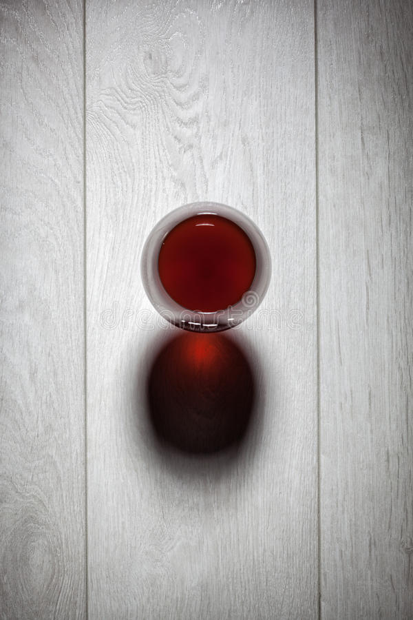 Glass of red wine on wooden table. stock images