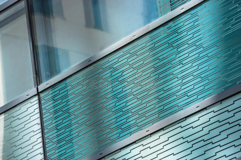 Glass reflection of a building. Glass reflection of another building on a very tall building royalty free stock photography