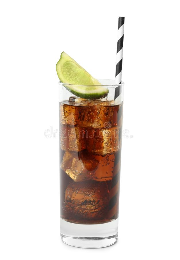 Glass of refreshing soda drink with ice cubes, lime and straw royalty free stock photography