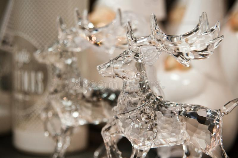 Glass reindeer figurines in a home decorations shop stock images