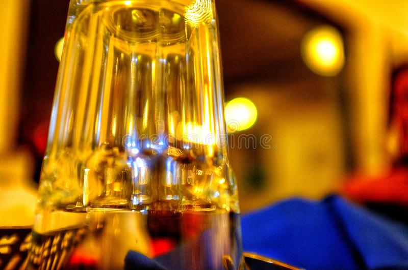 Glass resting in warm glow royalty free stock image