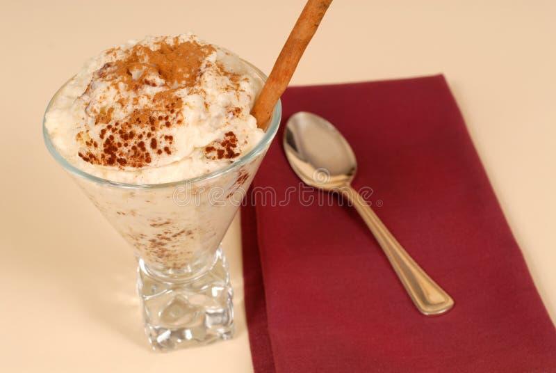 Glass of rice pudding with cinnamon stock image