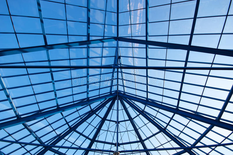 Glass roof. Blue sky through glass roof of modern biulding stock photo