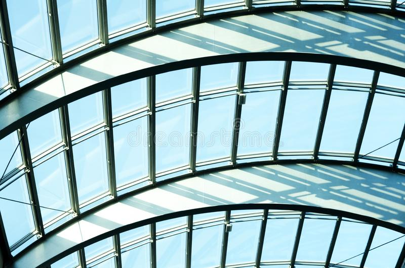 Glass roof of a modern building. In the city center against blue sky stock photo