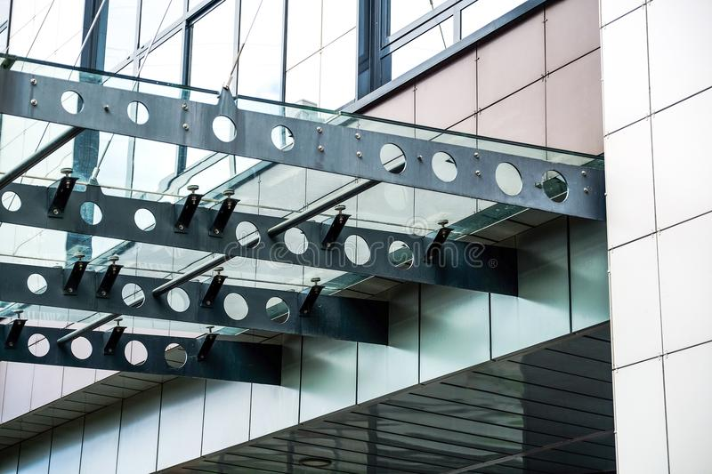Glass roof over the entrance. Reflection modern window facade office building background stock photos